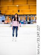 Купить «Asian woman ice skating indoor ice rink», фото № 33247227, снято 8 апреля 2020 г. (c) PantherMedia / Фотобанк Лори
