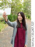 Купить «Asian Woman taking photo for herself», фото № 33247727, снято 8 апреля 2020 г. (c) PantherMedia / Фотобанк Лори