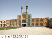 The Amir Chakhmaq Mosque complex facade at Yadz,  Iran. The mosque is located in a square with the same name. The prominent structure has a three storey elaborate facade of symmetrical sunken arched alcoves. Стоковое фото, фотограф Maurizio Bersanelli / PantherMedia / Фотобанк Лори