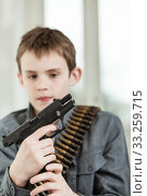 Купить «Young Boy with Bullet Belt Holding a Gun», фото № 33259715, снято 3 апреля 2020 г. (c) PantherMedia / Фотобанк Лори
