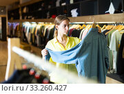 Купить «Female customer choosing male wear», фото № 33260427, снято 2 апреля 2020 г. (c) Яков Филимонов / Фотобанк Лори