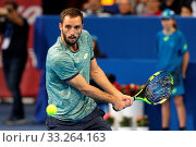 Sofia, Bulgaria - February 10, 2017: Viktor Troicki from Serbia (pictured) plays against Grigor Dimitrov from Bulgaria during a match from Sofia Open 2017 tennis tournament. Стоковое фото, фотограф Zoonar.com/Cylonphoto / age Fotostock / Фотобанк Лори