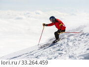Sofia, Bulgaria - March 12, 2016: Freestyle skier is skiing at the top of a snowy peak of Vitosha mountain covered in clouds. He is participating in an... Стоковое фото, фотограф Zoonar.com/Cylonphoto / age Fotostock / Фотобанк Лори