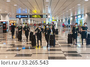 Купить «Singapore, Republic of Singapore, Asia - Upon their arrival at Changi Airport, flight attendants of the Taiwanese airline Eva Air wear protective masks to prevent an infection with the coronavirus.», фото № 33265543, снято 7 апреля 2020 г. (c) age Fotostock / Фотобанк Лори