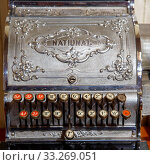 Budapest, Hungary - March 25, 2018: Antique cash register, buttons close up in chocolate museum. Стоковое фото, фотограф Zoonar.com/Ruslan Gilmanshin / easy Fotostock / Фотобанк Лори