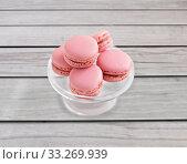 Купить «pink macaroons on glass confectionery stand», фото № 33269939, снято 6 июля 2018 г. (c) Syda Productions / Фотобанк Лори