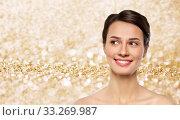 Купить «beautiful smiling young woman with bare shoulder», фото № 33269987, снято 30 ноября 2019 г. (c) Syda Productions / Фотобанк Лори