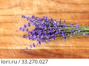 bunch of lavender flowers on wooden board. Стоковое фото, фотограф Syda Productions / Фотобанк Лори