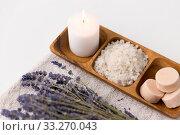 Купить «sea salt, soap, candle and lavender on bath towel», фото № 33270043, снято 8 ноября 2018 г. (c) Syda Productions / Фотобанк Лори
