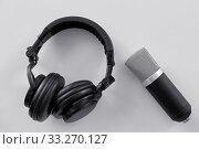 Купить «headphones and microphone on white background», фото № 33270127, снято 17 мая 2019 г. (c) Syda Productions / Фотобанк Лори