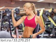 Купить «happy young woman with dumbbells exercising in gym», фото № 33270251, снято 23 марта 2013 г. (c) Syda Productions / Фотобанк Лори