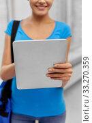 Купить «student woman with bag and tablet computer», фото № 33270359, снято 1 декабря 2013 г. (c) Syda Productions / Фотобанк Лори