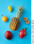 pineapple with other fruits on blue background. Стоковое фото, фотограф Syda Productions / Фотобанк Лори