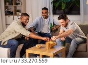 Купить «male friends drinking beer with crisps at home», фото № 33270559, снято 28 декабря 2019 г. (c) Syda Productions / Фотобанк Лори