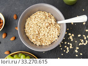 oatmeal cereals in bowl with spoon. Стоковое фото, фотограф Syda Productions / Фотобанк Лори
