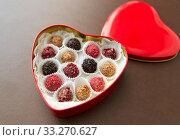 Купить «candies in red heart shaped chocolate box», фото № 33270627, снято 1 февраля 2019 г. (c) Syda Productions / Фотобанк Лори