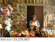 Woman resident of the island Madeira with knitted material and honey for sale, Madiera. October 2006. Стоковое фото, фотограф Edwin Giesbers / Nature Picture Library / Фотобанк Лори