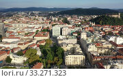 Купить «Panoramic aerial view of Ljubljana cityscape with buildings and streets, Slovenia», видеоролик № 33271323, снято 3 сентября 2019 г. (c) Яков Филимонов / Фотобанк Лори
