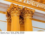 Top part of pillar, Greek-style columns with golden top, interior detail. Стоковое фото, фотограф Zoonar.com/Ruslan Gilmanshin / easy Fotostock / Фотобанк Лори