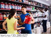 Купить «Young salesman offering supplements to woman», фото № 33280027, снято 7 апреля 2020 г. (c) Яков Филимонов / Фотобанк Лори