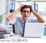 Купить «Young businessman under pressure in office to deliver tasks», фото № 33280415, снято 21 сентября 2017 г. (c) Elnur / Фотобанк Лори