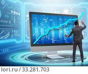 Businessman in economic forecasting concept with charts. Стоковое фото, фотограф Elnur / Фотобанк Лори