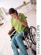Купить «Young male invalid in wheel-chair suffering at home», фото № 33281979, снято 23 июля 2019 г. (c) Elnur / Фотобанк Лори