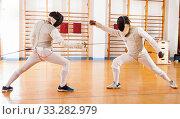 Fencers exercising techniques in battle. Стоковое фото, фотограф Яков Филимонов / Фотобанк Лори