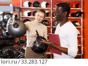 couple choosing motorcycle accessories and riding gear. Стоковое фото, фотограф Яков Филимонов / Фотобанк Лори