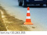 Купить «Warning traffic road cone stand on asphalt city road during roadworks», фото № 33283355, снято 27 августа 2019 г. (c) А. А. Пирагис / Фотобанк Лори