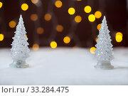 Купить «Two toy New Year trees against the background of fires. Bokeh», фото № 33284475, снято 10 августа 2018 г. (c) Екатерина Кузнецова / Фотобанк Лори