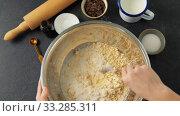 Купить «chef or baker making dough and pouring milk», видеоролик № 33285311, снято 15 февраля 2020 г. (c) Syda Productions / Фотобанк Лори
