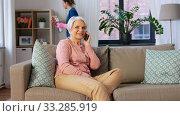 Купить «happy senior woman calling on smartphone at home», видеоролик № 33285919, снято 19 января 2020 г. (c) Syda Productions / Фотобанк Лори