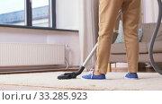 Купить «senior woman with vacuum cleaner cleaning at home», видеоролик № 33285923, снято 19 января 2020 г. (c) Syda Productions / Фотобанк Лори
