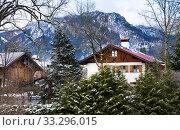 Schwangau village in winter snowy day. Alpen mountains and Neuschwanstein Castle on background (2020 год). Стоковое фото, фотограф Papoyan Irina / Фотобанк Лори