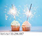 Two cupcakes decorated with sparklers. Стоковое фото, фотограф Ольга Сергеева / Фотобанк Лори