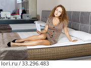 Купить «woman reading brochure while choosing new mattress», фото № 33296483, снято 22 октября 2018 г. (c) Яков Филимонов / Фотобанк Лори