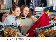 Купить «Two women choosing new blouse», фото № 33296507, снято 6 декабря 2018 г. (c) Яков Филимонов / Фотобанк Лори
