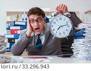 Купить «Businessman missing deadlines due to excessive work», фото № 33296943, снято 2 марта 2017 г. (c) Elnur / Фотобанк Лори