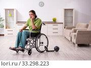 Купить «Young male invalid in wheel-chair suffering at home», фото № 33298223, снято 23 июля 2019 г. (c) Elnur / Фотобанк Лори