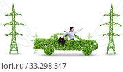 Купить «Electric car and green energy concept», фото № 33298347, снято 10 июля 2020 г. (c) Elnur / Фотобанк Лори