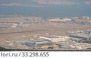 Купить «Aerial view at Chek Lap Kok airport from cable car cabin», видеоролик № 33298655, снято 9 ноября 2019 г. (c) Игорь Жоров / Фотобанк Лори
