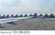 Купить «Airplane taxiing in Suvarnabhumi airport, Bangkok», видеоролик № 33298823, снято 30 ноября 2017 г. (c) Игорь Жоров / Фотобанк Лори