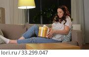 Купить «curious pregnant woman with gift box at home», видеоролик № 33299047, снято 22 февраля 2020 г. (c) Syda Productions / Фотобанк Лори
