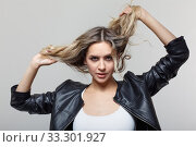 Portrait of young female with black leather jacket. Стоковое фото, фотограф Serg Zastavkin / Фотобанк Лори
