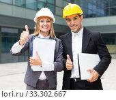 Купить «Couple architectors are satisfied with realisation their project», фото № 33302667, снято 20 августа 2017 г. (c) Яков Филимонов / Фотобанк Лори