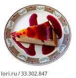 Купить «Classic cheesecake served with sweet berry sauce in cafe», фото № 33302847, снято 6 июля 2020 г. (c) Яков Филимонов / Фотобанк Лори