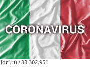 Inscription CORONAVIRUS on waving Italian flag. Стоковое фото, фотограф Kira_Yan / Фотобанк Лори