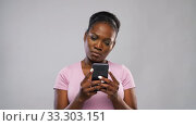 Купить «happy african american woman using smartphone», видеоролик № 33303151, снято 8 февраля 2020 г. (c) Syda Productions / Фотобанк Лори