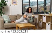 Купить «woman drinking tea and eating cake at home», видеоролик № 33303211, снято 24 февраля 2020 г. (c) Syda Productions / Фотобанк Лори